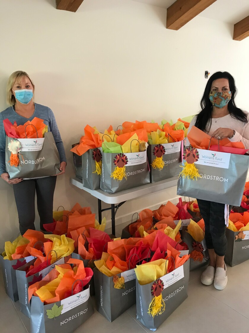 Rancho Santa Fe Women's Fund members preparing care packages.
