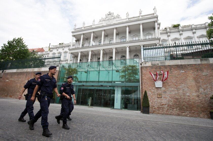 Police officers patrol in front of the Palais Coburg in Vienna, where talks between Iran, the United States, France, Britain, Germany, Russia and China continued on July 8.