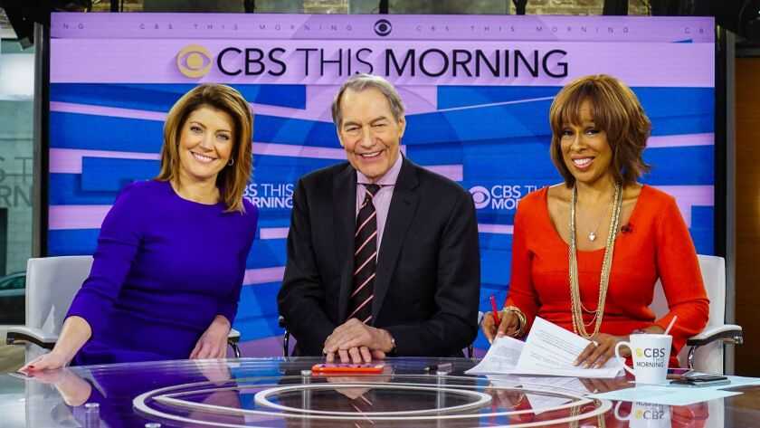 This Dec. 7, 2016 image released by CBS shows, from left, Norah O'Donnell, Charlie Rose and Gayle Ki
