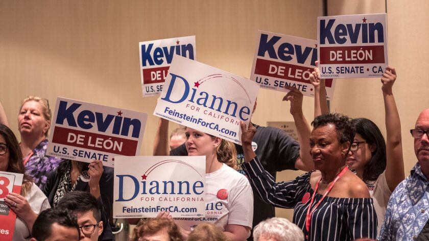 Jun 14, 2018 OAKLAND, CA. Supporters of Kevin de Leon and Dianne Feinstein hold signs during a meeti