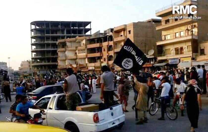 A photo posted by the militant group shows Islamic State fighters parading in Raqqah, Syria.