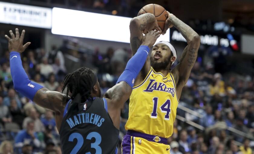 Lakers forward Brandon Ingram shoots against Dallas guard Wesley Matthews during a game Jan. 7 in Dallas.