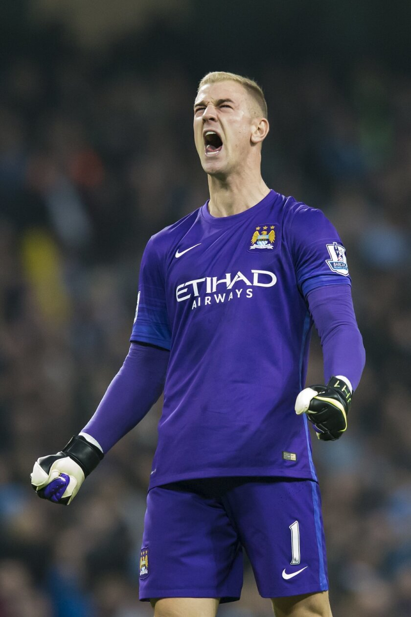 Manchester City's Joe Hart, who had earlier been at fault for an opposition goal, celebrates after a penalty is converted by teammate Yaya Toure during the English Premier League soccer match between Manchester City and Norwich at the Etihad Stadium, Manchester, England, Saturday Oct. 31, 2015. (AP