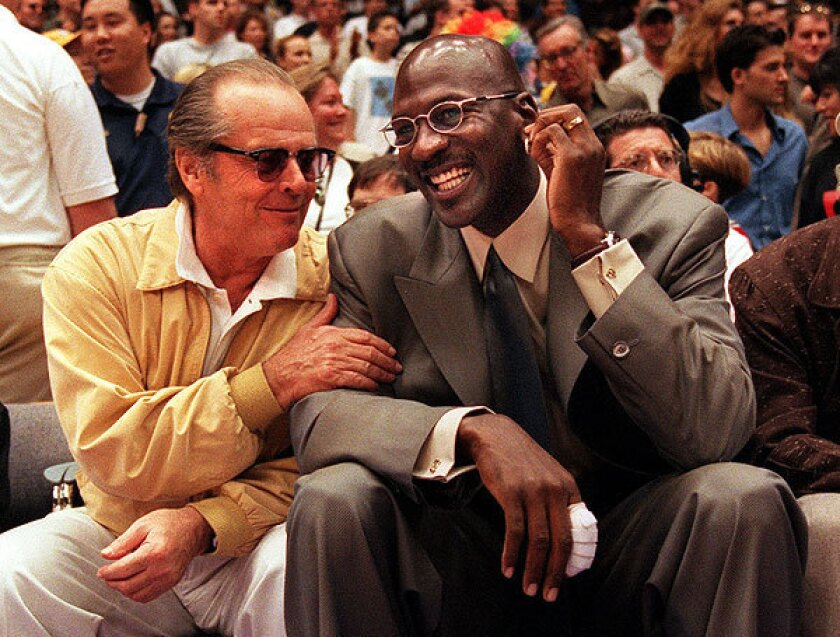 Michael Jordan with Jack Nicholson at the start of a Lakers game against the Houston Rockets in 1999.