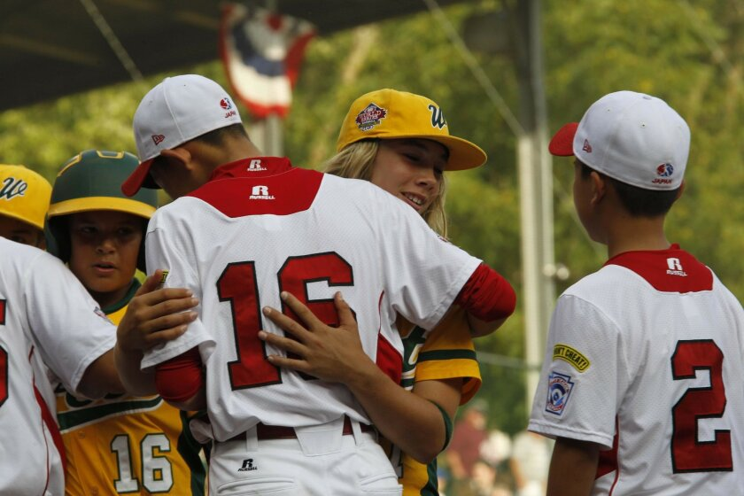 Micah Pietila-Wiggs congratulated Japanese players after the game. Japan took the Little League World Championship, beating out the Eastlake team from Chula Vista California on Sunday, August 25, 2013.