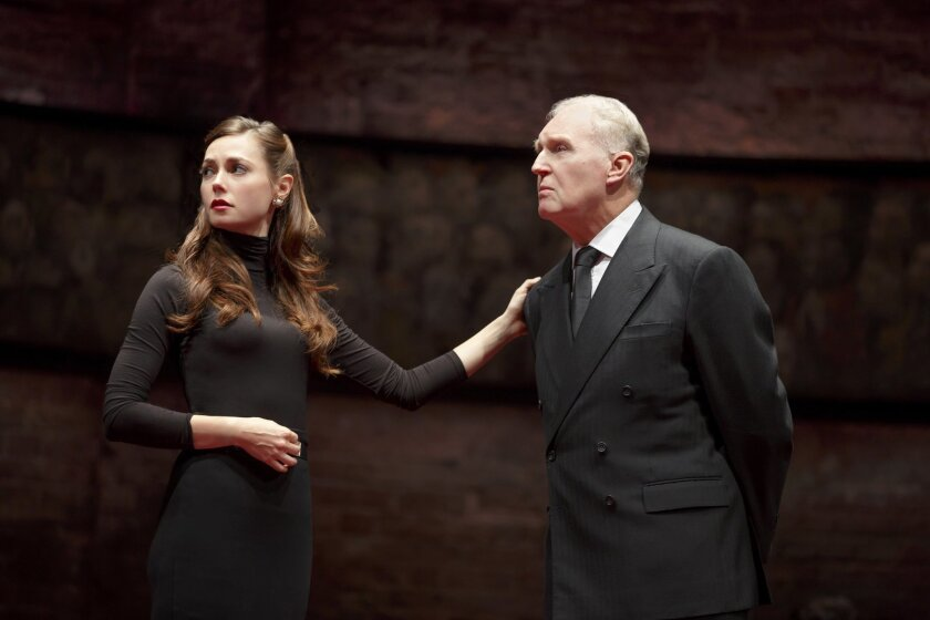 "This image released by The O + M Co. shows Lydia Wilson, left, and Tim Pigott-Smith during a performance of ""King Charles III,"" at the Music Box Theatre in New York. Pigott-Smith stars in Mike Bartlett's ""King Charles III,"" an ingenious view of what might happen when the Prince of Wales finally inh"