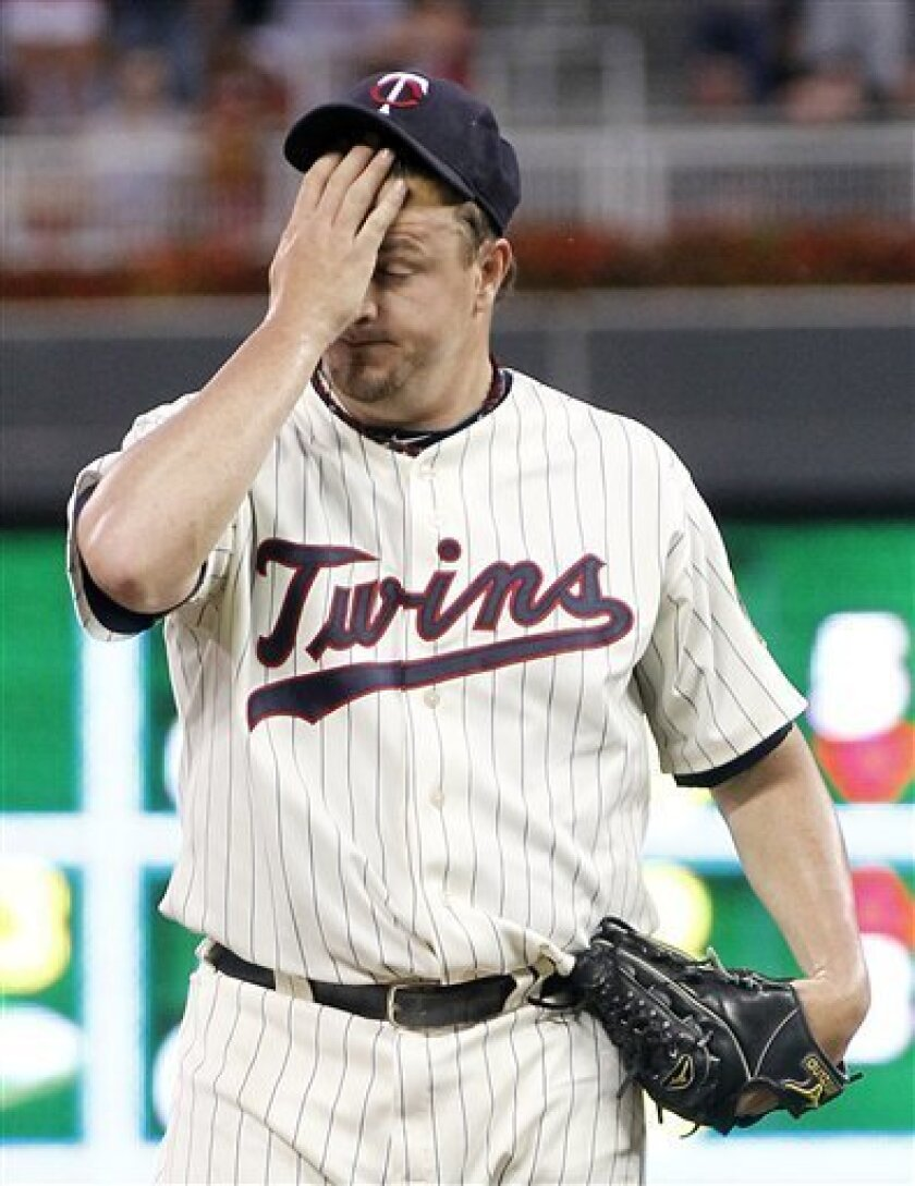 Minnesota Twins pitcher Matt Capps reacts after giving up a hit to the Milwaukee Brewers during the ninth inning of a baseball game, Saturday, July 2, 2011 in Minneapolis. The Brewers won 8-7. (AP Photo/Andy King)