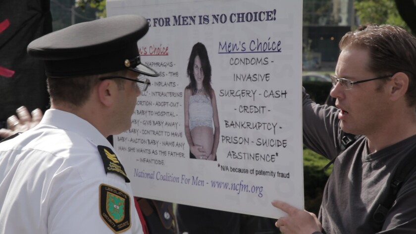 """A security guard and a men's rights activists protester in the documentary """"The Red Pill."""""""