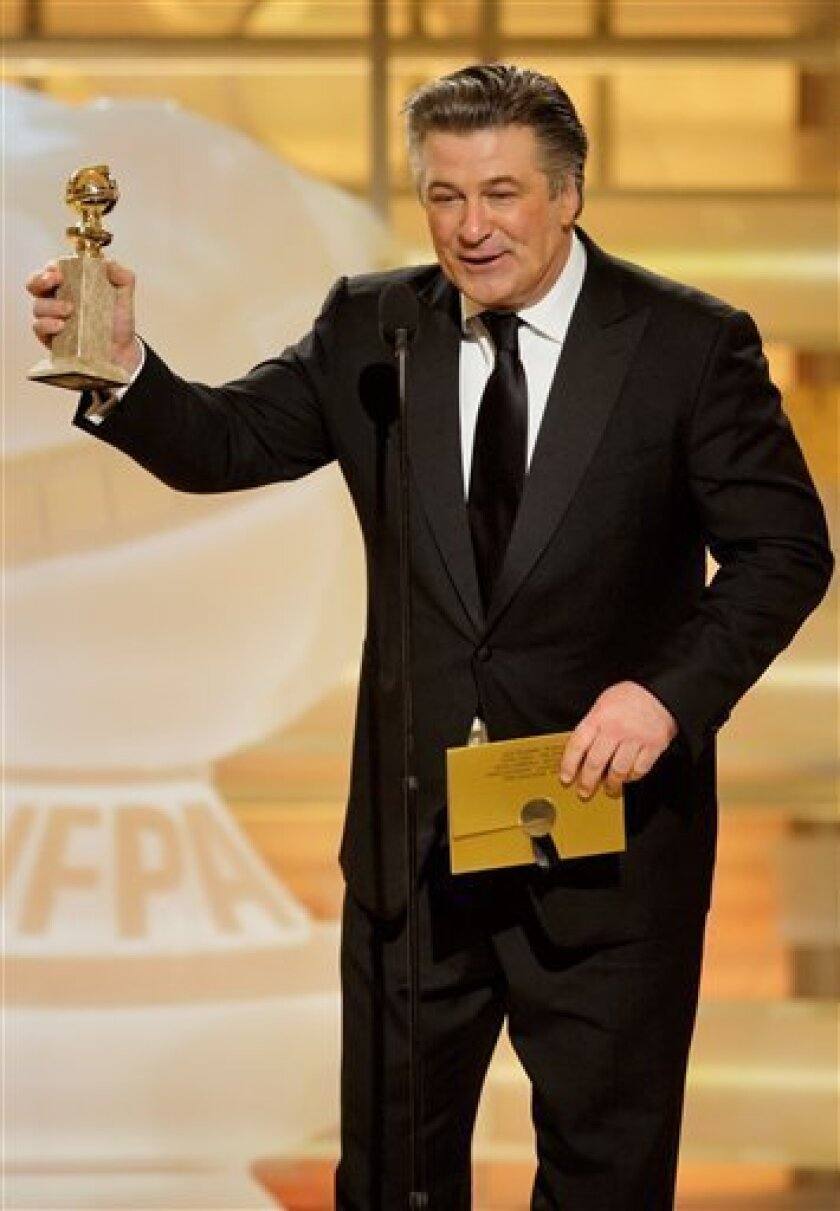 """In this handout image, provided by NBC, Alec Baldwin accepts the award for Best Actor - TV Series, Musical or Comedy for """"30 Rock"""" on stage during the 66th Annual Golden Globes Awards on Sunday Jan. 11, 2009 in Beverly Hills, Calif. (AP Photo/NBC,Paul Drinkwater)"""