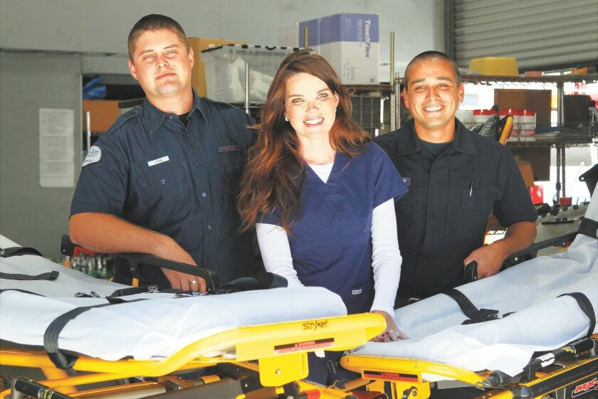 Meghan McCool of Care Care Ambulance Service has been underwriting tuition for EMT students at Palomar College and EMSTA school in Santee for the last seven years. McCool is shown here with Jacob Rowe, left, and Eldon McCarthy who were recipients.