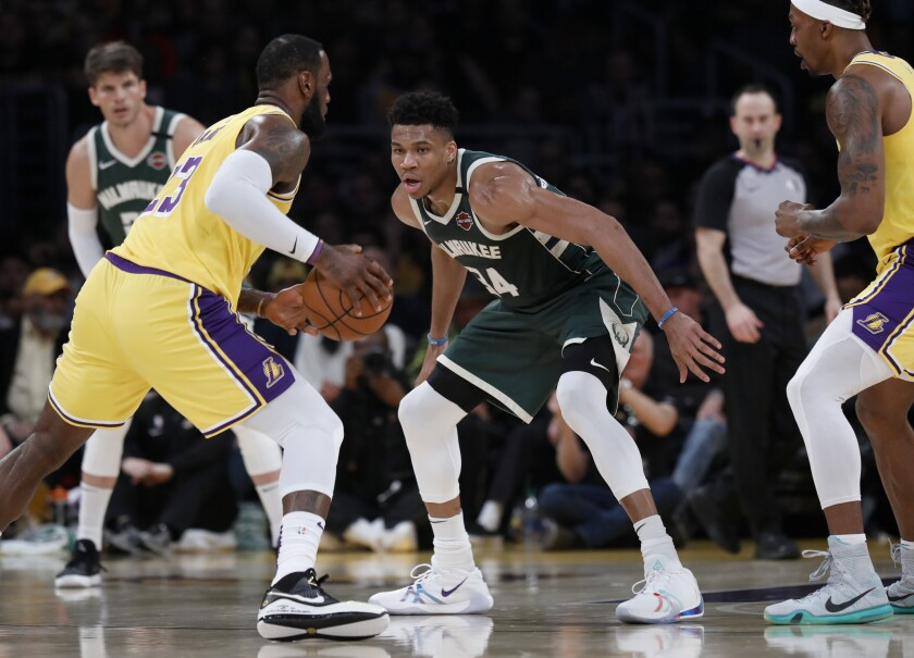 Lakers forward LeBron James (23) is guarded by Bucks forward Giannis Antetokounmpo (34) during a game March 6, 2020.