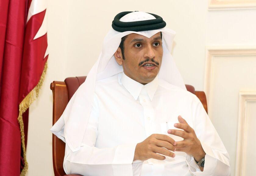 Qatari Foreign Minister Mohammed bin Abdulrahman al Thani speaks to a reporter in Doha on June 8.