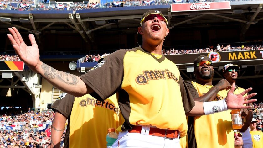 Manny Machado cheers during the T-Mobile Home Run Derby in July 2016 at Petco Park, which is now his home stadium as the newest member of the Padres.