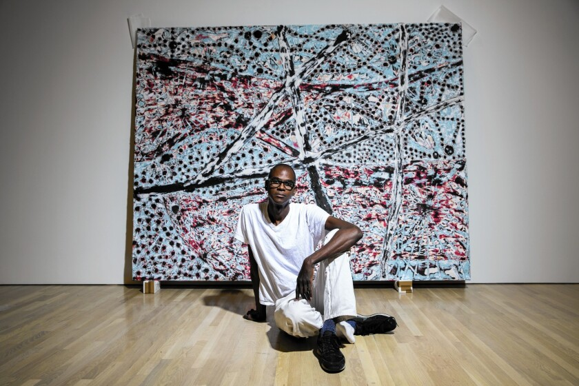"""A+P founder Mark Bradford in front of his piece """"The Next Hot Line"""" from his 2015 """"Scorched Earth"""" show at the Hammer Museum."""