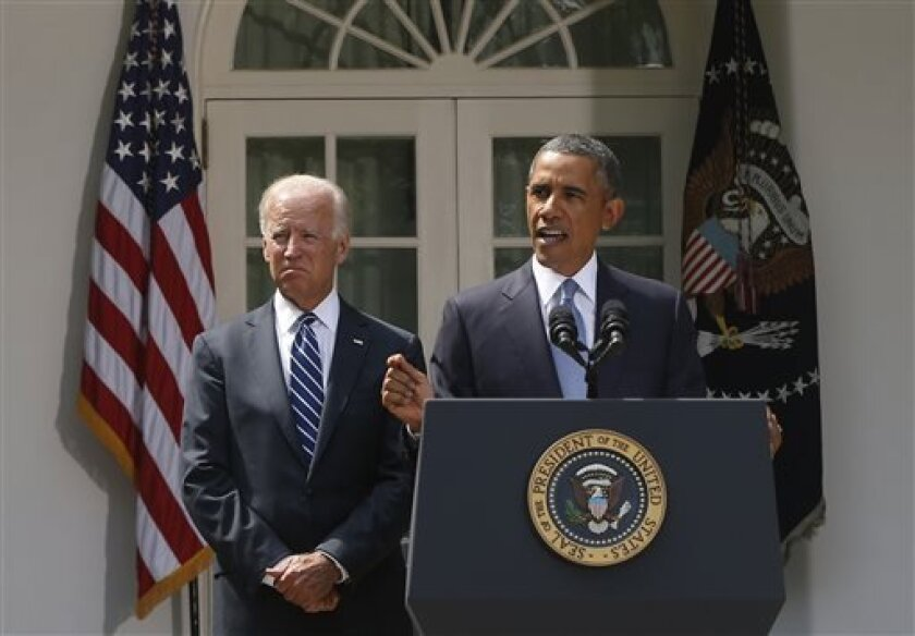 President Barack Obama stands with Vice President Joe Biden as he makes a statement about the crisis in Syria in the Rose Garden at the White House in Washington, Saturday, Aug. 31, 2013. Delaying what had appeared to be an imminent strike, Obama abruptly announced Saturday he will seek congressional approval before launching any military action meant to punish Syria for its alleged use of chemical weapons in an attack that killed hundreds. (AP Photo/Charles Dharapak)