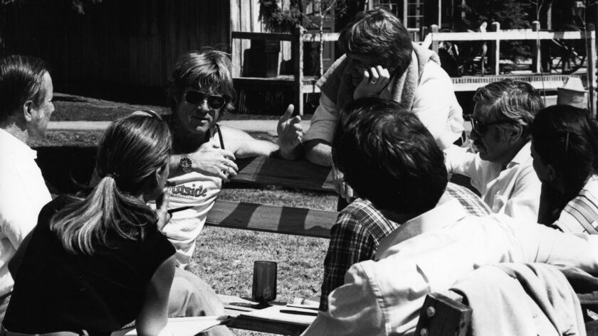Sterling Van Wagenen, center top, with Robert Redford, facing camera left, and other participants at the first Filmmakers Lab in 1981, an early project of the Sundance Institute.