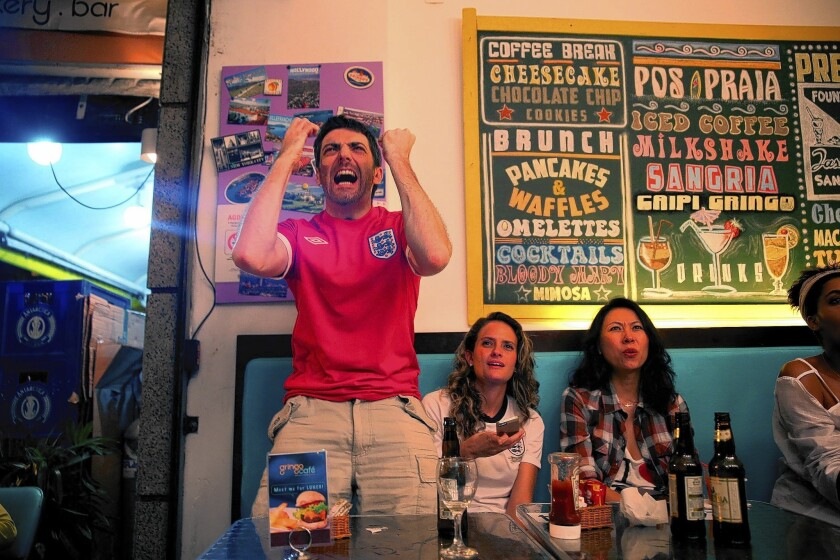 Mike Hughson of Chester, England, is fully engaged at a Rio de Janeiro cafe in June watching England play Italy. Italy won, 2-1.