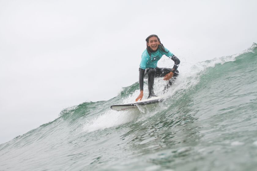 Annabelle Wirths-Tihanyi catches a wave.