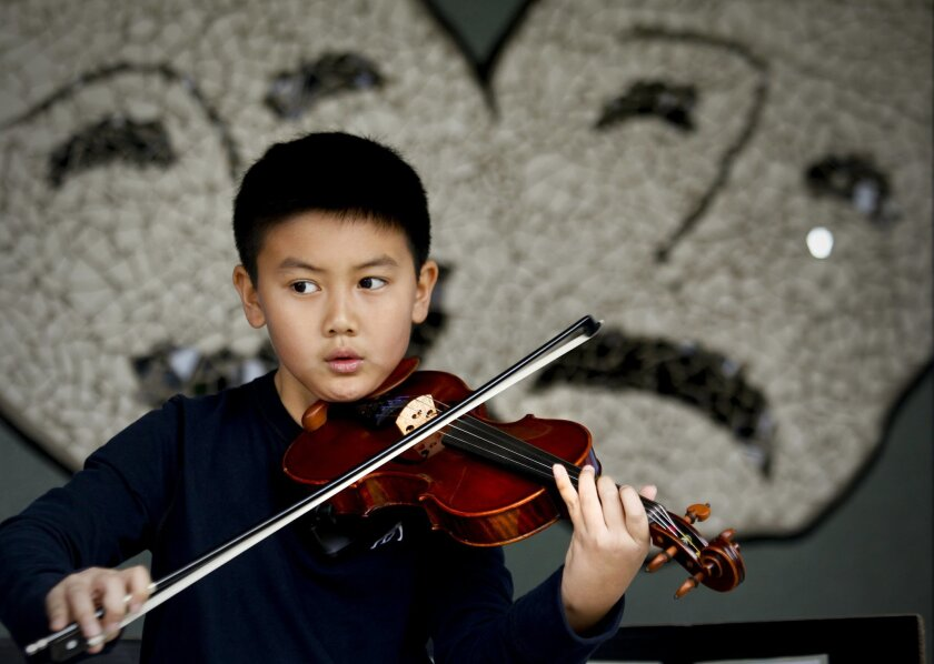 Crown Point Junior Music Academy third-grader Joshua Nguyen. HOWARD LIPIN • U-T