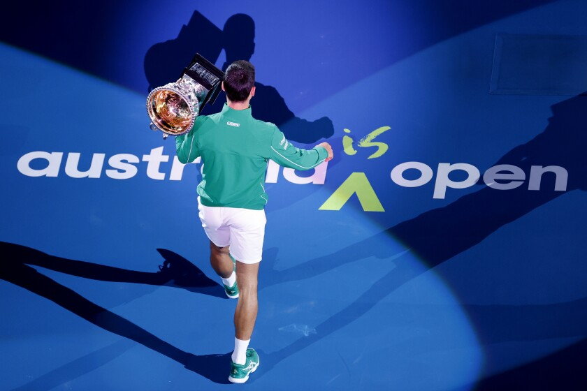 Novak Djokovic holds his trophy after winning the 2020 Australian Open in Melbourne on Feb. 3.