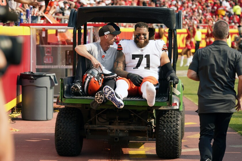 Cleveland Browns offensive tackle Jedrick Wills Jr. (71) is taken off on a cart during the first half of an NFL football game against the Kansas City Chiefs Sunday, Sept. 12, 2021, in Kansas City, Mo. Wills was injured while blocking on a Jarvis Landry touchdown run in the first quarter. Browns coach Kevin Stefanski did not provide a specific timeline on Wills' return. (AP Photo/Charlie Riedel)