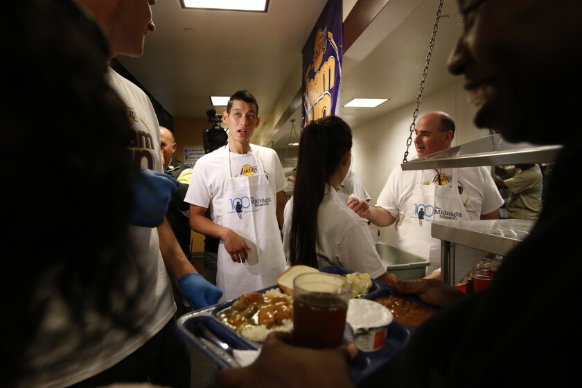 After joining the Lakers, Jeremy Lin joins teammates and Lakers staff at skid row's Midnight Mission, serving food and passing out gift bags.