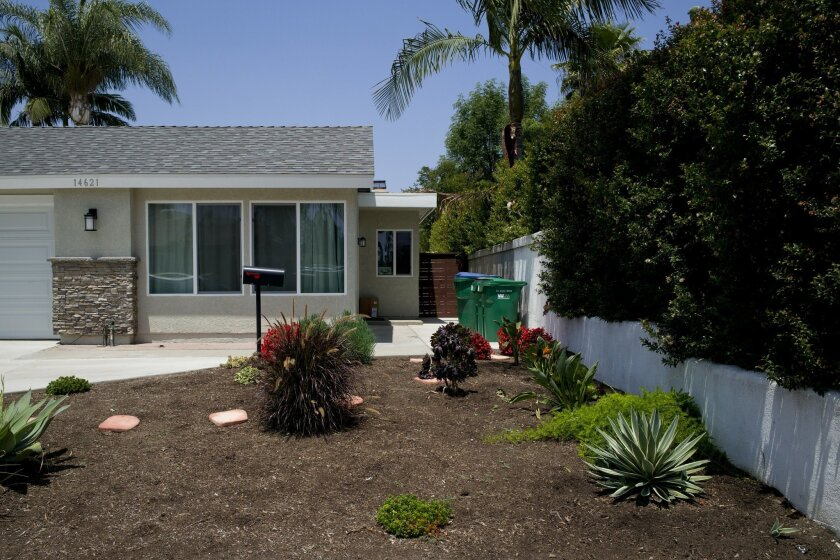 A drought-tolerant garden is seen on Wednesday, May 18, 2016, in Irvine, Calif. California water officials say they will consider dropping a mandate requiring conservation in the state's fifth year of drought. (AP Photo/Jae C. Hong)