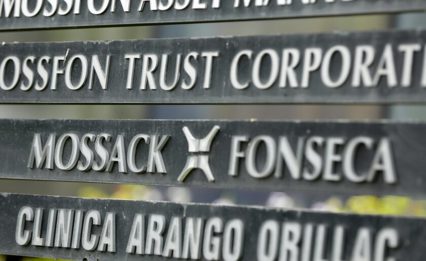 FILE - In this April 4, 2016 file photo, a marquee on a building in Panama City, Panama, lists the Mossack Fonseca law firm, one of the leaders in setting up offshore bank accounts for the rich and powerful. Offshore accounts conjure up images of malicious misdeeds, but many people use them for mor