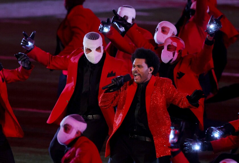 The Weeknd performs at the Pepsi Super Bowl LV Halftime Show at Raymond James Stadium