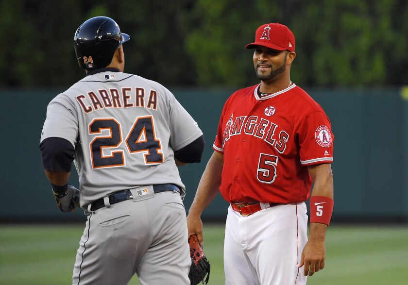 Detroit Tigers designated hitter Miguel Cabrera, left, jogs past Angels first baseman Albert Pujols after hitting a solo home run Monday.