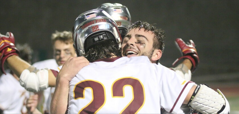 Face-off specialist Teagan Bultman (facing) and forward Dewey Egan were jubilant in victory.
