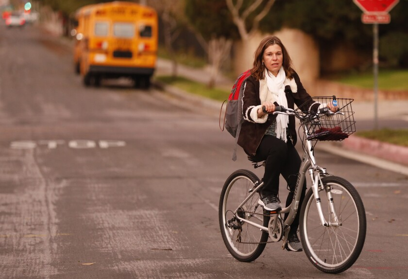 Fabiana Lamm, a school psychologist in the Valley, rides her bike to her work. The focus has been on the teachers, but the union includes positions such as hers.