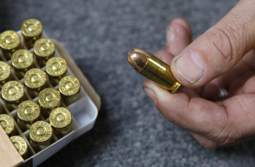 FILE - In this June 11, 2019, file photo, Chris Puehse, owner of Foothill Ammo, displays .45-caliber ammunition for sale at his store in Shingle Springs, Calif. California could expand its law requiring unique identifiers on every bullet casing to include weapons used by law enforcement, a move that proponents said is another attempt to help investigate shootings by police. (AP Photo/Rich Pedroncelli, File)