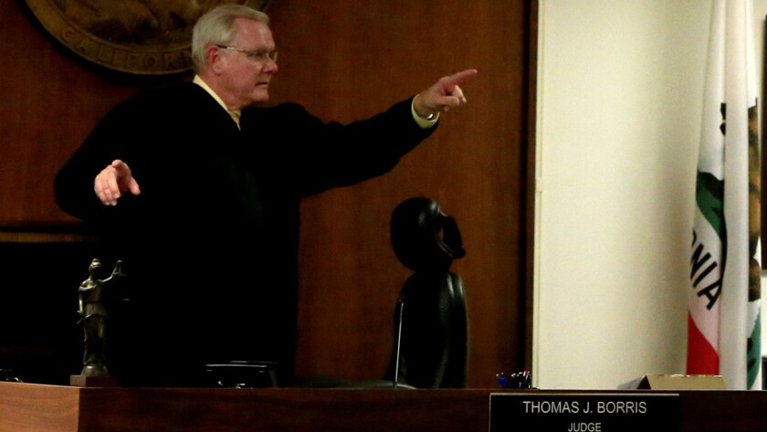 Judge Thomas Borris, seen in February 2014 in his Westminster courtroom, has been examining recalled cases amid a probe into apparent fraud involving Orange County court records.
