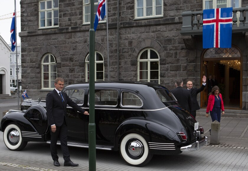 """Iceland's president Guðni Th. Jóhannesson waves as he gets into a car following his inauguration in Reykjavik, Iceland Saturday Aug. 1, 2020. In Iceland, a nation so safe that its president runs errands on a bicycle, U.S. Ambassador Jeffery Ross Gunter has left locals aghast with his request to hire armed bodyguards. He's also enraged lawmakers by casually and groundlessly hitching Iceland to President Donald Trump's controversial """"China virus"""" label for the coronavirus. (AP Photo/Árni Torfason)"""