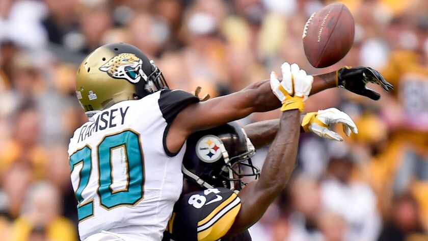 Jaguars cornerback Jalen Ramsey deflects a pass intended for Steelers wide receiver Antonio Brown that went to Jaguars strong safety Barry Church for an interception in the teams' Oct. 8 game.