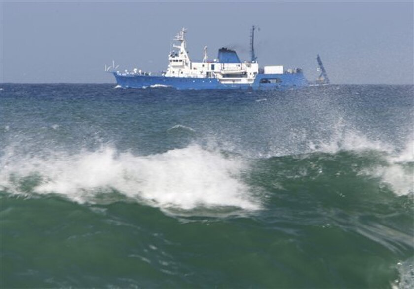 The Ocean Alert ship is seen off the shore taking part in the search for the people who were aboard the plane and the black box of the Ethiopian Airlines plane that crashed on Monday into the sea, in Beirut, Lebanon, on Sunday, Jan. 31, 2010. (AP Photo/Hussein Malla)
