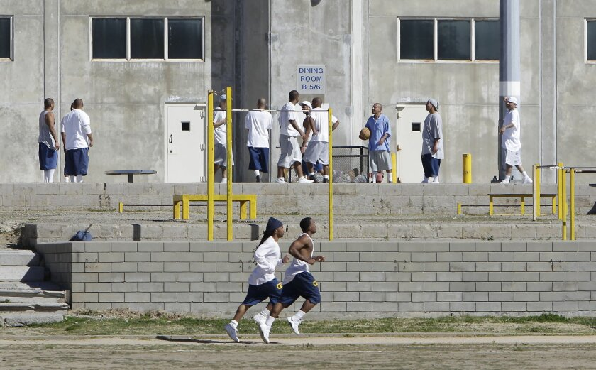 In this 2013 file photo, inmates work out in the exercise yard of Housing Unit B at California State Prison Sacramento, near Folsom. Gov. Gavin Newsom wants to close two state prisons.