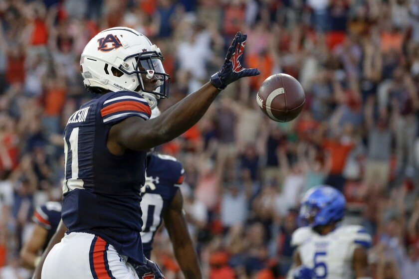 Auburn wide receiver Shedrick Jackson (11) celebrates after he catches a pass for a touchdown over Georgia State cornerback Quavian White (20) to take the lead in the final minute of the second half of an NCAA football game Saturday, Sept. 25, 2021, in Auburn, Ala. Auburn won 34-24. (AP Photo/Butch Dill)