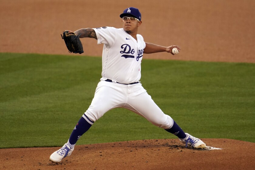 Los Angeles Dodgers starting pitcher Julio Urias throws to a Seattle Mariners batter during the first inning of a baseball game Wednesday, May 12, 2021, in Los Angeles. (AP Photo/Marcio Jose Sanchez)