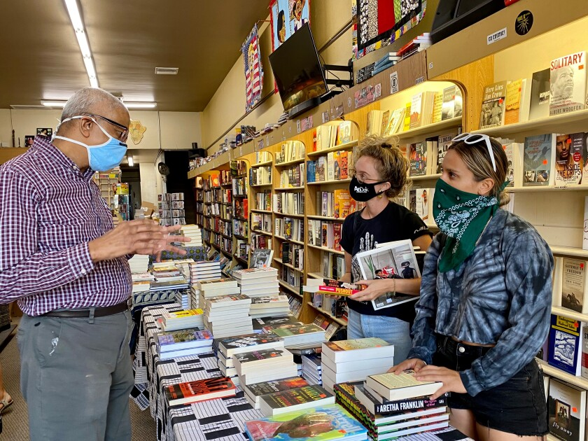 Eso Won Books co-owner James Fugate speaks with customers.