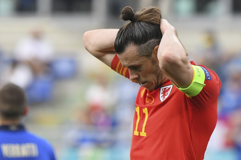 Wales' Gareth Bale reacts after missing a chance during the Euro 2020 soccer championship group A match between Italy and Wales at the Stadio Olimpico stadium in Rome, Sunday, June 20, 2021. (Alberto Lingria/Pool via AP)