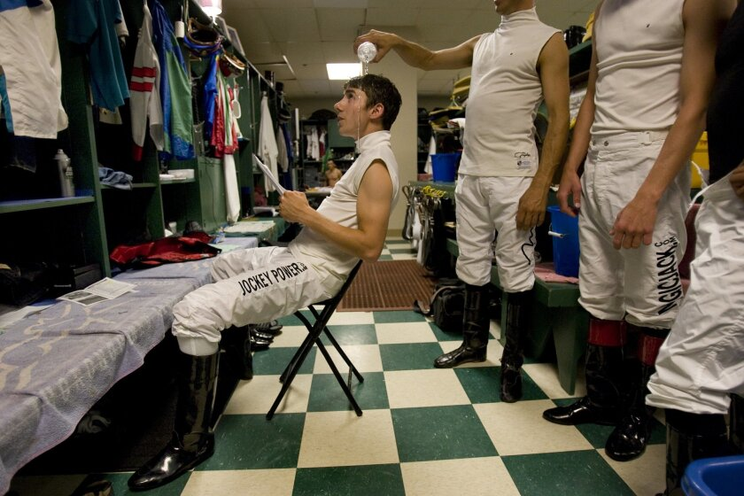 A fellow rider pours water over Joe Talamo's head — one of many pranks perpetrated in the jockeys' room at Del Mar.