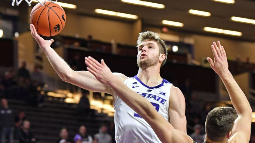 Dean Wade of the Kansas State Wildcats drives in for a basket against the Lehigh Mountain Hawks.