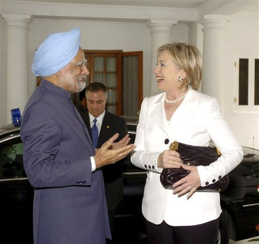 In this photo released by the Government of India, Indian Prime Minister Manmohan Singh, left, talks to U.S. Secretary of State Hillary Rodham Clinton in New Delhi, India, Monday, July 20, 2009. Nearly a year and a half into Barack Obama's presidency, Indians still worry that their country is taking a back seat to rivals China and Pakistan in U.S. foreign policy priorities. (AP Photo/Government of India Photo Division/B.M.Meena)