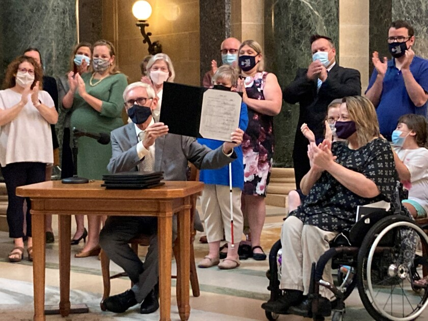 Wisconsin Gov. Tony Evers vetoes Republican bills that would have made it more difficult to vote absentee in the battleground state during a news conference in the Capitol rotunda on Tuesday, Aug. 10, 2021, in Madison, Wis. (AP Photo/Scott Bauer)