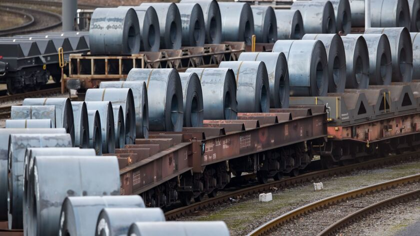 Coils are stored on trains in front of the ThyssenKrupp steel mill in Duisburg, Germany, on March 5.