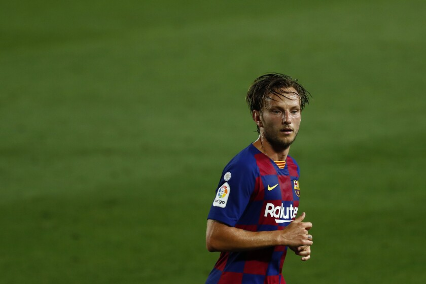 Barcelona's Ivan Rakitic runs for the ball during the Spanish La Liga soccer match between FC Barcelona and RCD Espanyol at the Camp Nou stadium in Barcelona, Spain, Wednesday, July 8, 2020. (AP Photo/Joan Monfort)