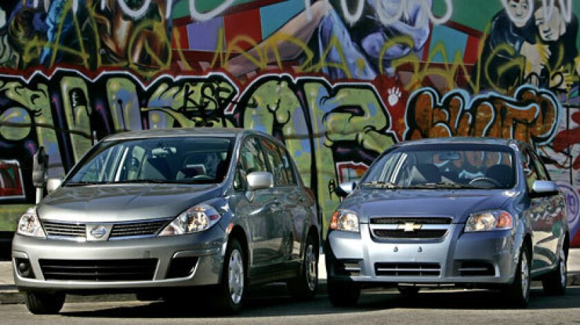Nissan Versa, left, and Chevy Aveo