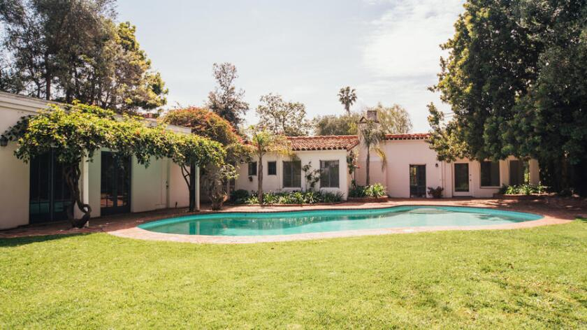 The hacienda-style home in Brentwood sits on about half an acre with a kidney-shaped swimming pool.